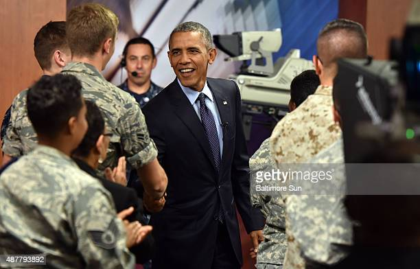 President Obama shakes hands with service members after attending a militry town hall meeting at Fort Meade in Maryland on Friday Sept 11 the 14th...