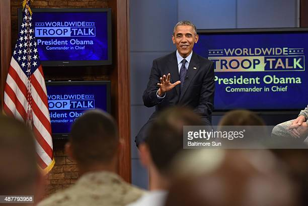 President Obama shares a light moment with service members in a town hall meeting at Fort Meade in Maryland on Friday Sept 11 2015