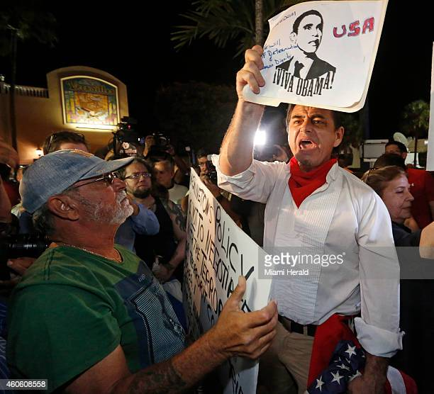 President Obama supporter Peter Bell right debates with antiObama demonstrators at Versaille's Restaurant in Miami on Wednesday Dec 17 after...