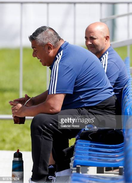 President of AFA Claudio Tapia talks Jorge Sampaoli coach of Argentina during a training session at Training site at Stadium of Syroyezhkin Sports...