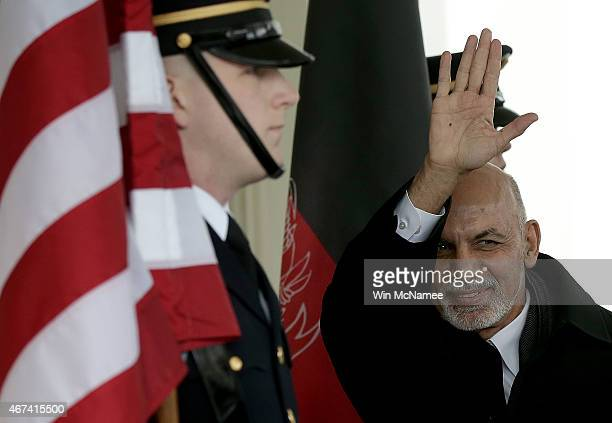 President of Afghanistan Ashraf Ghani waves as he arrives at the White House March 24 2015 in Washington DC Ghani is scheduled to meet with US...