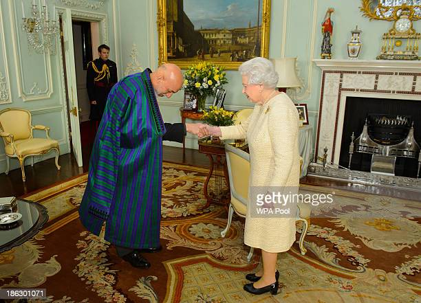 President of Afghanistan Hamid Karzai attends an audience with Queen Elizabeth II at Buckingham Palace on October 30, 2013 in London, England. The...