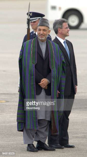 President of Afghanistan Hamid Karzai center stands with Deputy US Chief of Protocol Jeff Eubank after his arrival to Hunter Army Airfield Georgia on...