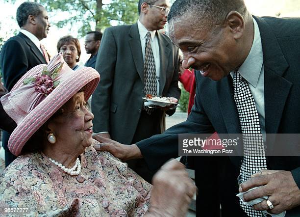 President of Africare C Payne Lucas leans over to greet Dr Dorothy Height who just arrived at Lucas' retirement party at Africare House on July 11...