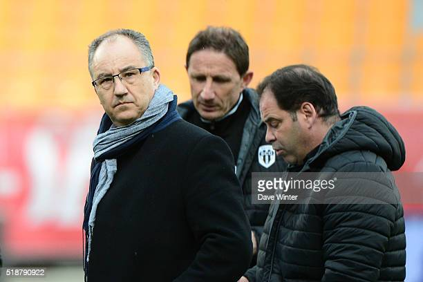 President of Angers Said Chabane and Angers assistant coach Serge Le Dizet and Angers coach Stephane Moulin during the French Ligue 1 match between...
