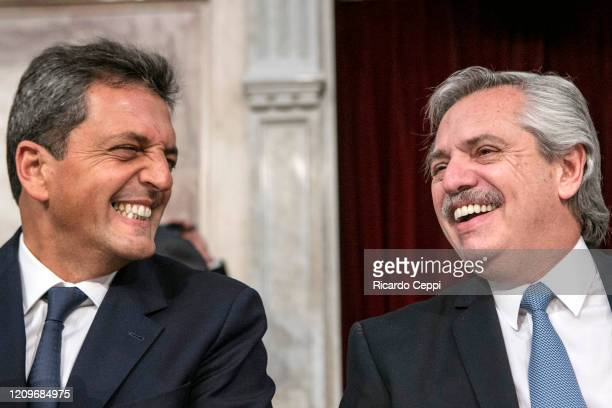 President of Argentina Alberto Fernandez and Deputy Sergio Massa laugh during the opening session of the 138th period of the Argentine Congress on...