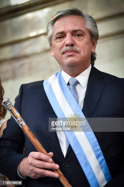 President of Argentina Alberto Fernandez poses with the presidential sash and presidential cane during the Presidential Inauguration Ceremony at...