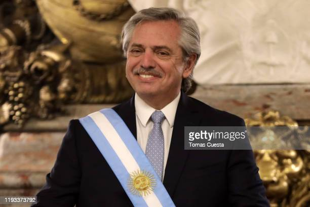 President of Argentina Alberto Fernandez smiles during the reception of foreign leaders at Salon Blanco of Casa Rosada Government Palace on December...