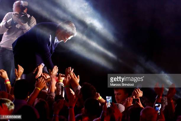 President of Argentina and candidate for reelection Mauricio Macri greets supporters of Juntos Por El Cambio after conceding the election against...