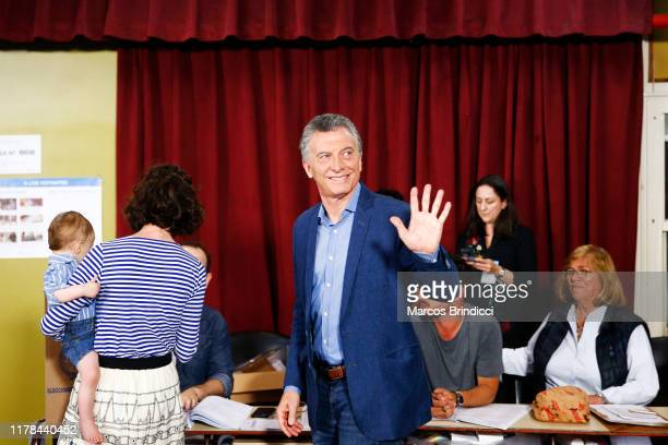President of Argentina and Presidential candidate Mauricio Macri of 'Juntos por el Cambio' waves to the media as he casts his vote during the...