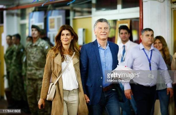 President of Argentina and Presidential candidate Mauricio Macri of 'Juntos por el Cambio' arrives with First Lady of Argentina Juliana Awada to cast...