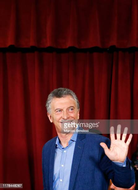 President of Argentina and Presidential candidate Mauricio Macri of 'Juntos por el Cambio' waves to the media as he casts his vote on October 27,...