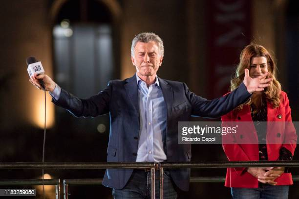 President of Argentina and Presidential candidate Mauricio Macri gestures along with the First Lady of Argentina Juliana Awada during his closing...