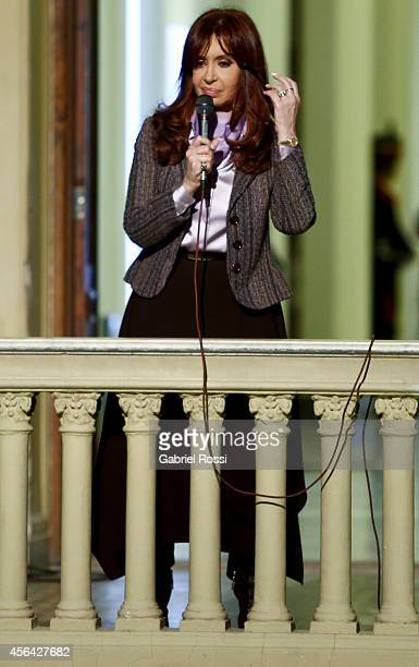 President of Argentina Cristina Fernandez de Kirchner speaks in front of her supporters after a press conference at the Presidential Palace on...
