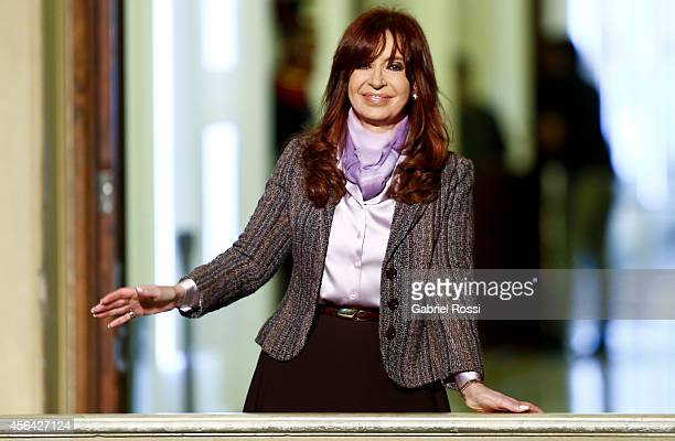President of Argentina Cristina Fernandez de Kirchner waves to her supporters after a press conference at the presidential palace on September 30...