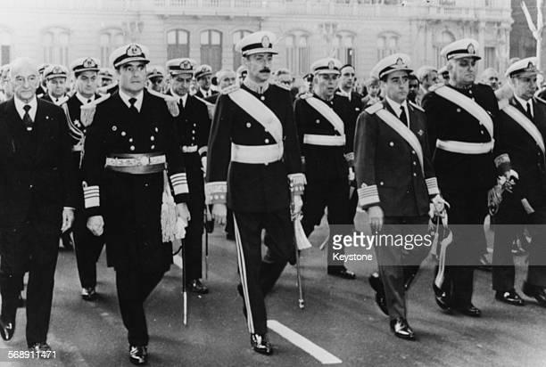 President of Argentina Jorge Rafael Videla marching with Admiral Emilio Eduardo Massera and Brigadier General Orlando Ramon Agosti as they celebrate...