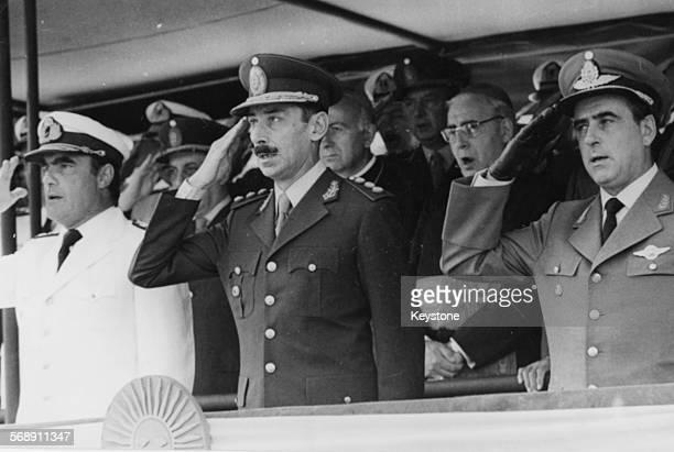 President of Argentina Jorge Rafael Videla with Admiral Emilio Eduardo Massera and Brigadier General Orlando Ramon Agosti saluting as the National...
