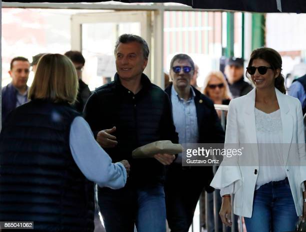 President of Argentina Mauricio Macri and his wife Juliana Awada look on during the Parliament elections at Wenceslao Posse school on October 22 2017...