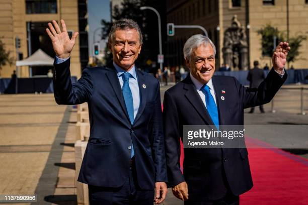 President of Argentina Mauricio Macri and President of Chile Sebastián Piñera wave to the media prior to the meeting of Presidents of South America...