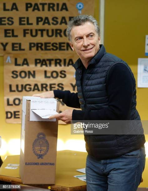 President of Argentina Mauricio Macri casts his vote during the midterm primary elections at Wencesleao Posse Nª16 school on August 13 2017 in Buenos...