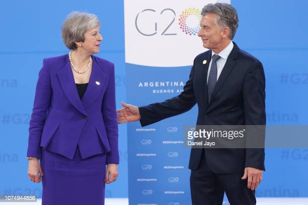 President of Argentina Mauricio Macri greets British Prime Minister Theresa May upon her arrival to the opening day of Argentina G20 Leaders' Summit...