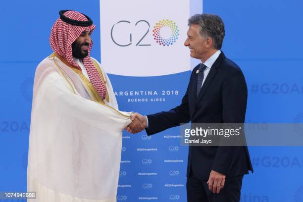 President of Argentina Mauricio Macri greets Crown Prince of Saudi Arabia Mohammad bin Salman al-Saud upon his arrival to the opening day of...