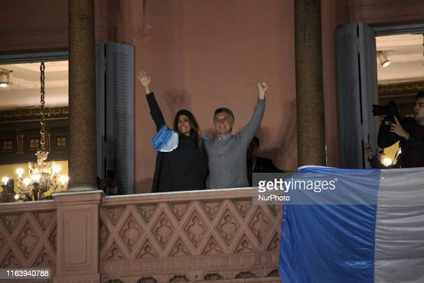 President of Argentina Mauricio Macri greets people marching from Obelisco monument to Casa Rosada to support him in Buenos Aires Argentina on August...