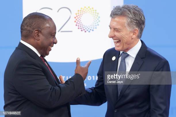 President of Argentina Mauricio Macri greets President of South Africa Matamela Cyril Ramaphosa upon his arrival to the opening day of Argentina G20...