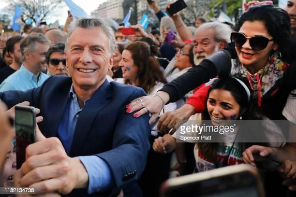 President of Argentina Mauricio Macri greets supporters as he enters his closing presidential campaign rally called 'La Marcha del Millón' of Juntos...