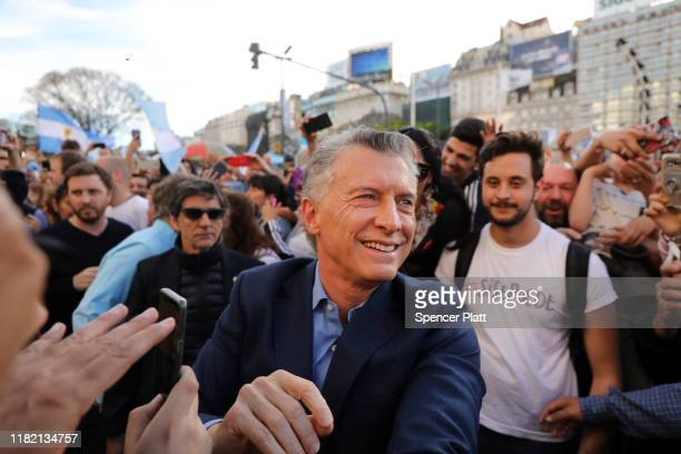 President of Argentina Mauricio Macri greets supporters as he enters his closing presidential campaign rally called 'La Marcha del Millón' of Juntos...