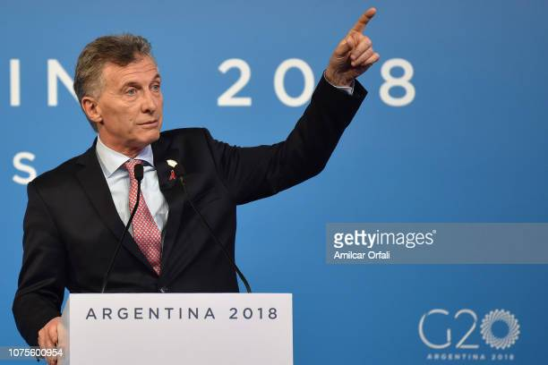 President of Argentina Mauricio Macri leaves the stage after answering questions during the closing press conference on day 2 of sessions of...