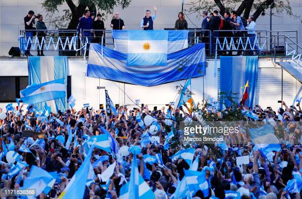 President of Argentina Mauricio Macri waves to his supporters alongside the Mayor of Buenos Aires Horacio Rodriguez Larreta and the First Lady...