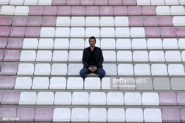 President of AS Cannes Johan Micoud poses at the Pierre de Coubertin stadium in Cannes on September 19 2017 / AFP PHOTO / VALERY HACHE
