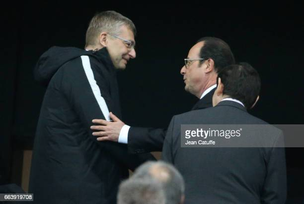 President of AS Monaco Dmitri Rybolovlev greets French President Francois Hollande during the French League Cup final between Paris SaintGermain and...