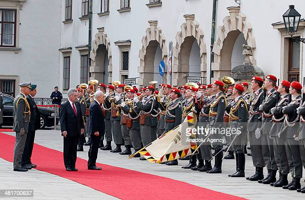 President of Austria Heinz Fischer and Israel President Shimon Peres review the honor guard during a welcoming ceremony at Hofburg palace in Vienna,...