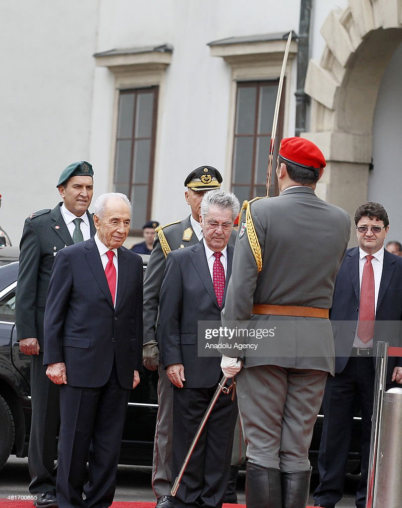 President of Austria Heinz Fischer (R) and Israel President Shimon Peres (L) review the honor guard during a welcoming ceremony at Hofburg palace in Vienna, Austria on March 31, 2014.