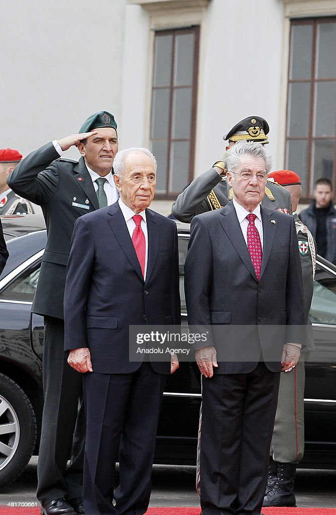 President of Austria Heinz Fischer (R) welcomes Israel President Shimon Peres (L) during a welcoming ceremony at Hofburg palace in Vienna, Austria on March 31, 2014.