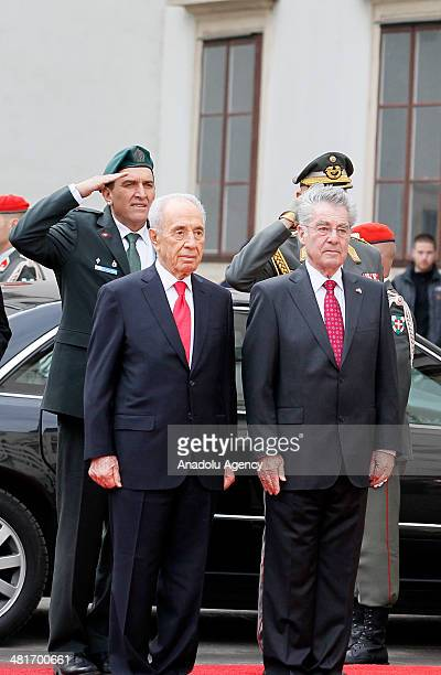 President of Austria Heinz Fischer welcomes Israel President Shimon Peres during a welcoming ceremony at Hofburg palace in Vienna, Austria on March...