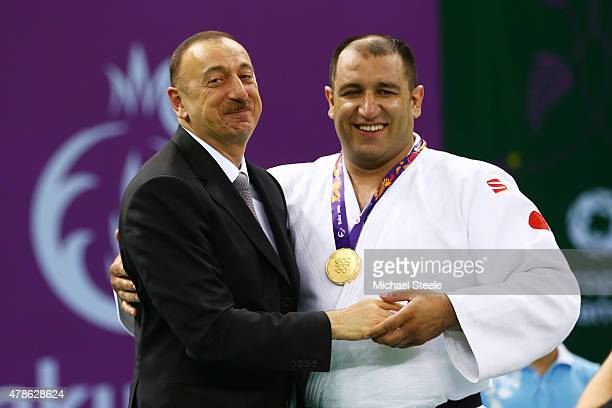 President of Azerbaijan Ilham Aliyev congratulates Gold medalist Ilham Zakiyev of Azerbaijan after presenting the medal won in the Men's Visually...