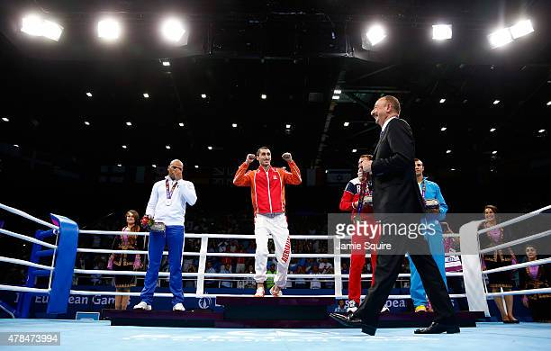 President of Azerbaijan Ilham Aliyev present medals to silver medalist Valentino Manfredonia of Italy gold medalist Teymur Mammadov of Azerbaijan and...
