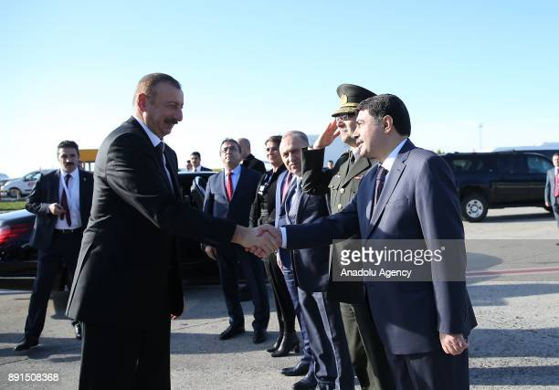 President of Azerbaijan Ilham Aliyev shakes hands with Governor of Istanbul Vasip Sahin ahead of his departure after attending the extraordinary...