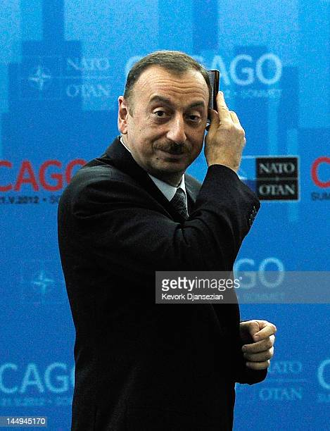 President of Azerbaijan Ilham Heydar combs his hair as he arrives for a meeting on Afghanistan during the NATO Summit at McCormick Place on May 21...