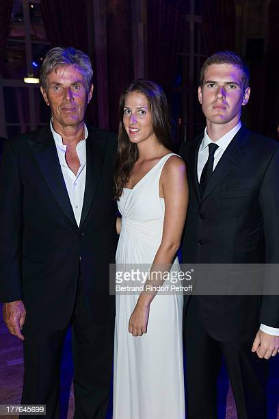 President of Barriere Group Dominique Desseigne, his children Joy and Alexandre attend the Grand Bal Care in Deauville on August 24, 2013 in...