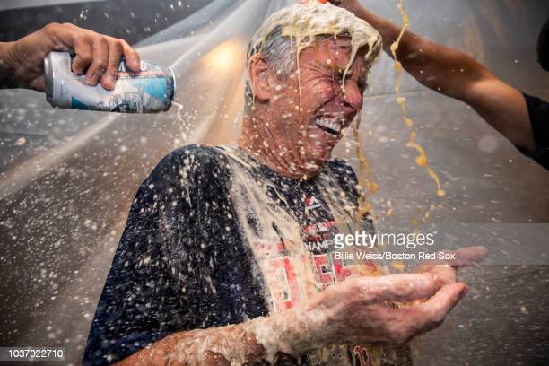 President of Baseball Operations Dave Dombrowski of the Boston Red Sox celebrates in the clubhouse after clinching the American League East division...