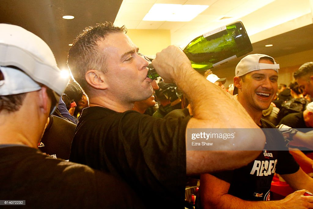 President of Baseball Operations for the Chicago Cubs, Theo Epstein, celebrates in the locker room after defeating the San Francisco Giants 6-5 in Game Four of their National League Division Series to advance to the National League Championship Series at AT&T Park on October 11, 2016 in San Francisco, California.