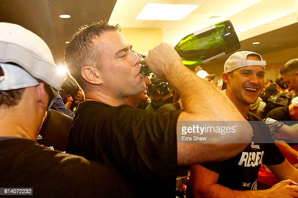 President of Baseball Operations for the Chicago Cubs Theo Epstein celebrates in the locker room after defeating the San Francisco Giants 65 in Game...