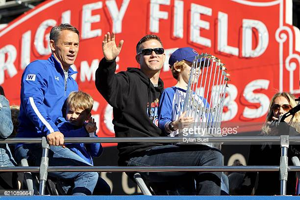 President of Baseball Operations for the Chicago Cubs Theo Epstein waves to the crowd during the 2016 World Series victory parade on November 4 2016...