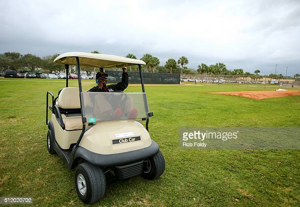 President of baseball operations Michael L Hill sits in a golf cart during a Miami Marlins workout on February 23 2016 in Jupiter Florida
