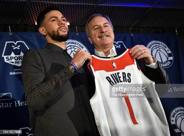 President of basketball operations Ernie Grunfeld right poses with newest acquisition Austin Rivers left as the Wizards hold a press conference on...