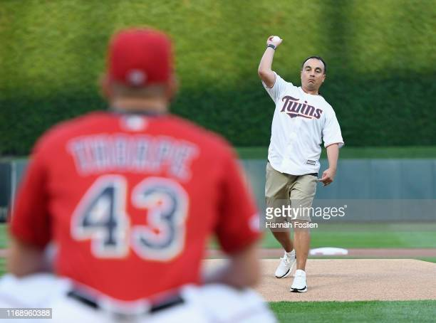 President of Basketball Operations Gersson Rosas of the Minnesota Timberwolves delivers a ceremonial pitch before the game between the Minnesota...